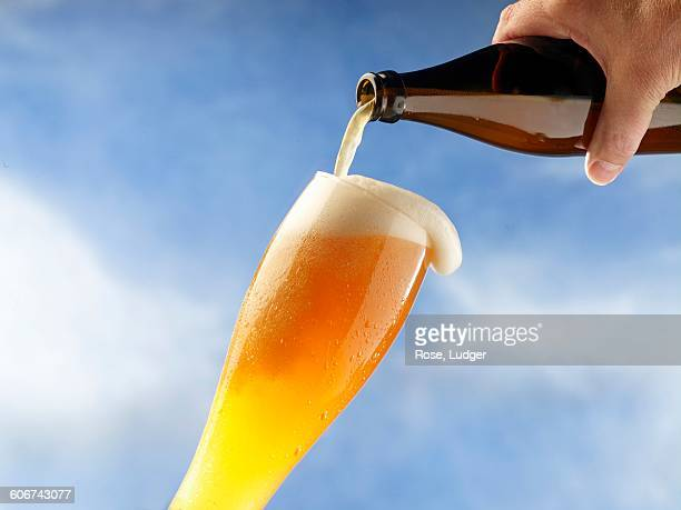 A wheat beer being poured