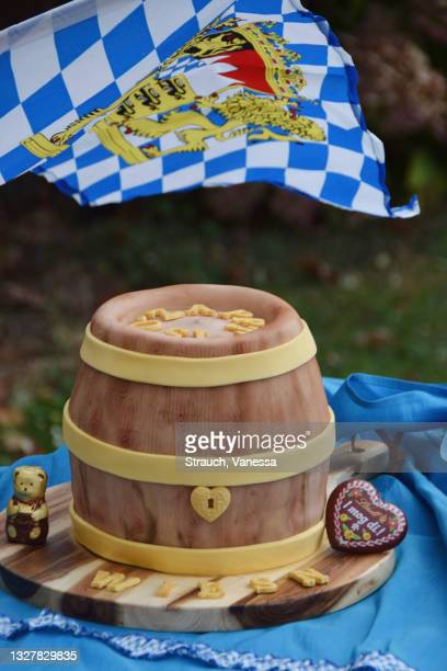 a wheat beer, peanut, and banana keg for oktoberfest - marzipan stock pictures, royalty-free photos & images