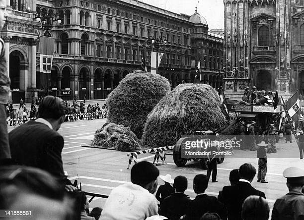 Wheat grown in the war gardens being threshed in Piazza del Duomo Milan 26 July 1943