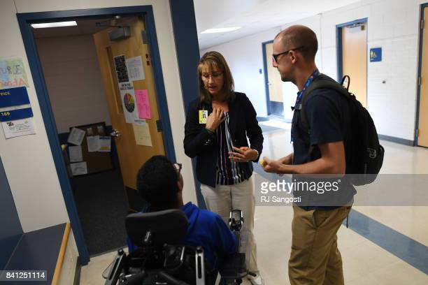 Wheat Ridge High School's nurse Rhonda Valdez center was recently hired with a grant where Colorado schools are splitting $92 million in grant...