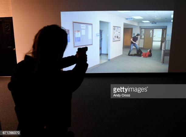 Wheat Ridge police officer Charlotte Aines works a shoot don't shoot scenario on the Ti Training training lab use of force simulator at the Frank...