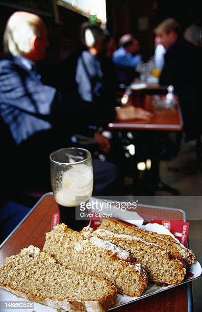 wheaten bread and pint of guinness at kitchen bar restaurant. - guinness stock pictures, royalty-free photos & images