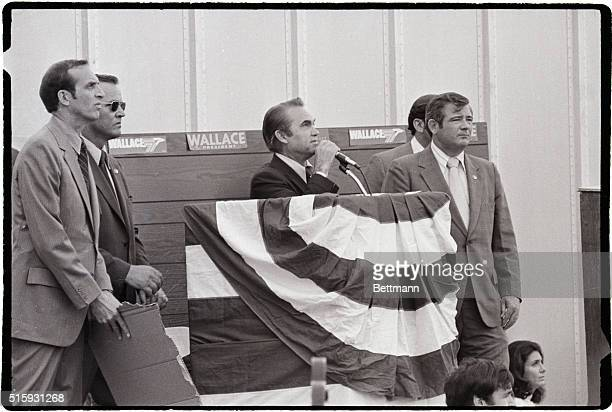 Security Guards close by Alabama's Gov George C Wallace campaigning for the Democratic Presidential nomination speaks at the Wheaton Plaza shopping...