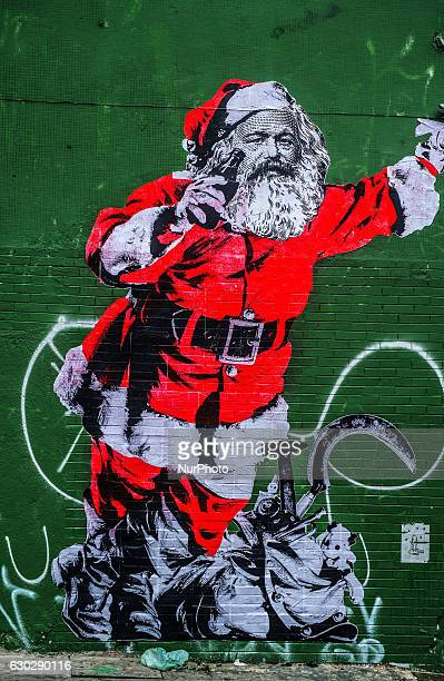 Wheatpaste of the socialist philosopher Karl Mar dressed in Santa Claus and taking coca cola is seen in the neighborhood of Rua da Consolação in São...