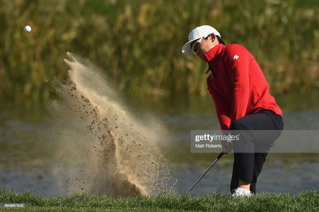 Whee Kim of South Korea hits out of the 18th green bunker during the final round of the CJ Cup at Nine Bridges on October 22, 2017 in Jeju, South Korea.