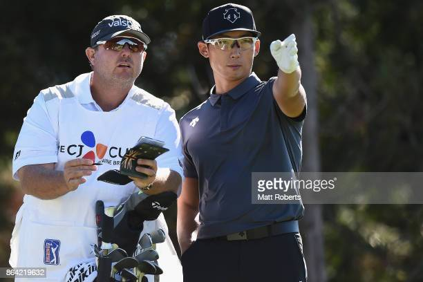 Whee Kim of South Korea speaks with his caddie during the third round of the CJ Cup at Nine Bridges on October 21 2017 in Jeju South Korea