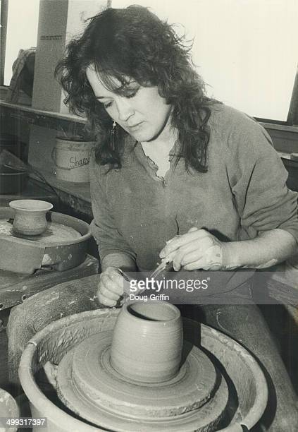 Wheel artist Cathy Graham a student at George Brown College's twoyear ceramics program works on a jar form on a pottery wheel Ceramics In The City...