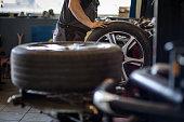 Wheel balancing or repair and change car tire at auto service garage