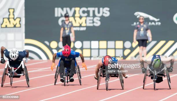 Wheel chair athletics takes place as Prince Harry looks on on day 2 of the Invictus Games Toronto 2017 on September 24 2017 in Toronto Canada The...