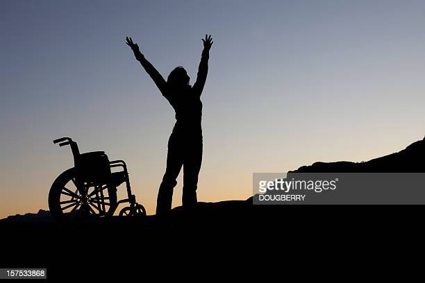 wheel chair silhouette - miracle stock photos and pictures