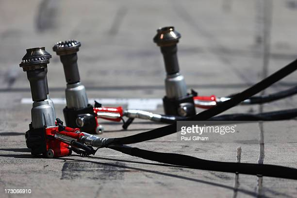 Wheel guns in the pitlane before qualifying for the German Grand Prix at the Nuerburgring on July 6 2013 in Nuerburg Germany
