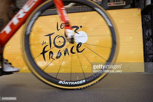 A wheel is pictured in front of the logo of the Tour de France during the signature ceremony prior to the 1625 km seventh stage of the 103rd edition...