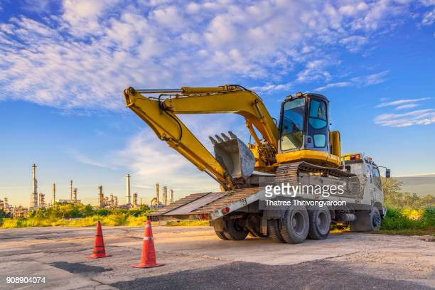 Wheel loader excavator machine  cars park on the truck at the construction site
