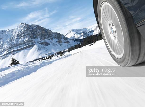 Wheel of car on road in winter