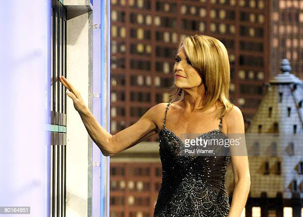 Wheel of Fortune cohost Vanna White turns a letter while taping episodes of the game show at Navy Pier on March 7 2008 in Chicago Illinois