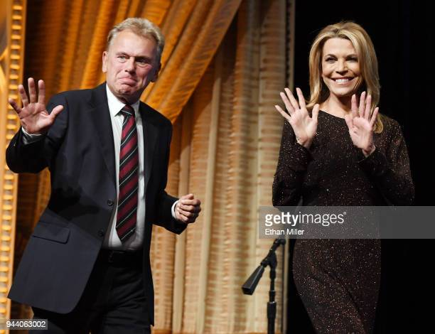 """Wheel of Fortune"""" host Pat Sajak and hostess Vanna White walk onstage as they are inducted into the National Association of Broadcasters Broadcasting..."""
