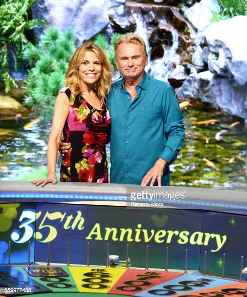 'Wheel of Fortune' hosts Vanna White and Pat Sajak attend a taping of the Wheel of Fortune's 35th Anniversary Season at Epcot Center at Walt Disney...