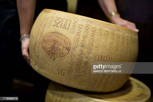 A wheel of Parmigiano Reggiano Parmesan cheese is pictured on October 18 2019 in a cheese shop in Saluzzo near Turin With Washington starting to...