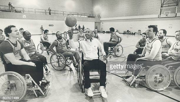 Wheel to wheel Curly Neal of the Globetrotters displays his ball handling skills for the Toronto Spitfires at the Eboticke Olympium The Trotters and...
