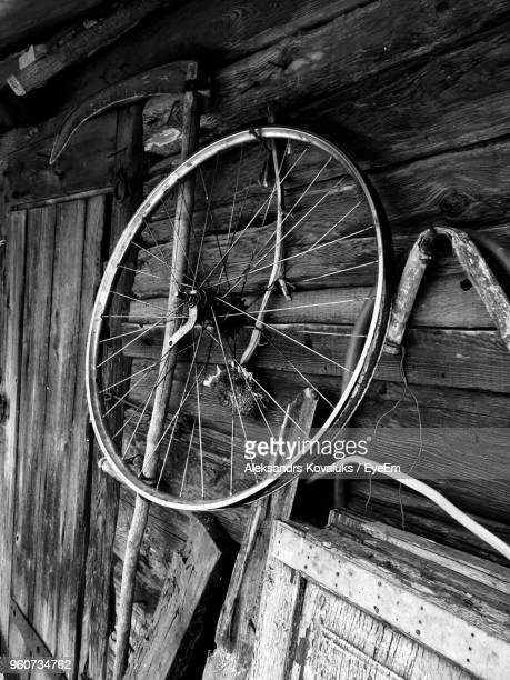 Wheel With Hand Tools Hanging On Wooden Wall
