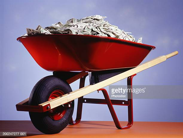 Wheelbarrow filled with money