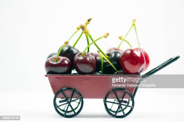 Wheelbarrow full of sweets and tasty cherries