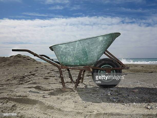 wheelbarrow ocean - wheelbarrow stock photos and pictures