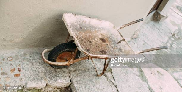 wheelbarrow - caceres stock pictures, royalty-free photos & images