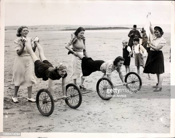 A New Seaside Sport Wheelbarrow racing with an axle and two rubber tyred wheels is the latest exercise and sport on the Coney Beach sands at...