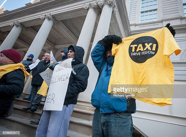 Wheelchair advocates joined by taxi and livery drivers rally on the steps of New York City Hall on Tuesday, January 19, 2016 against the City...