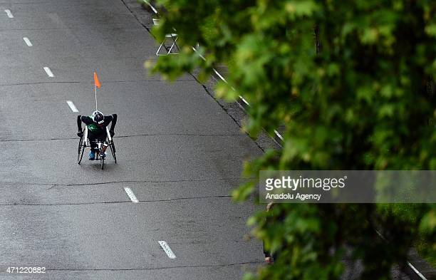 A wheelchair athlete competes in the 38th 'Rock 'N Roll Madrid Marathon 1/2' including a marathon a 10km race and a half marathon in Madrid Spain on...