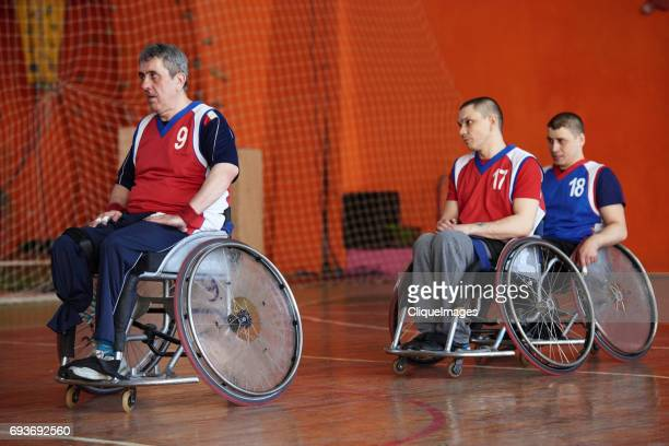 wheelchair athletes having break on court - cliqueimages stock pictures, royalty-free photos & images