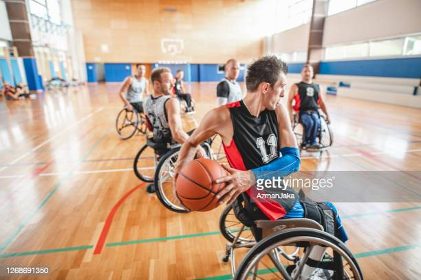 wheelchair basketball action during practice game - competition group stock pictures, royalty-free photos & images