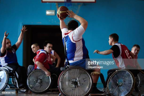 wheelchair basketball match - cliqueimages stockfoto's en -beelden