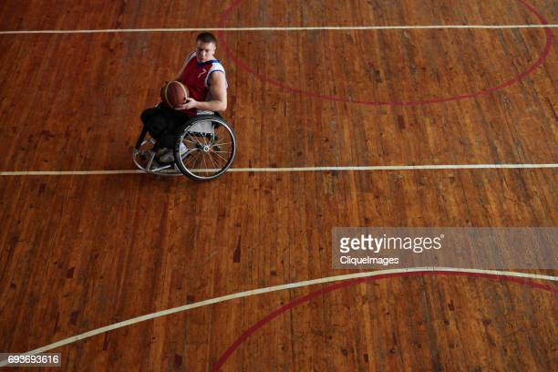 wheelchair basketball player with ball - cliqueimages ストックフォトと画像