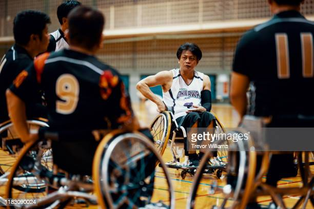 wheelchair basketball team talking together after a game - team photo ストックフォトと画像