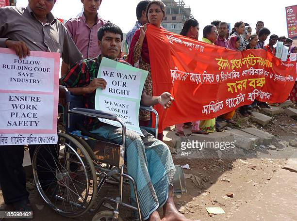 Wheel-chair bound garment factory worker joins other demonstrators at the site of the Rana Plaza garment factory building collapse in Savar, the...