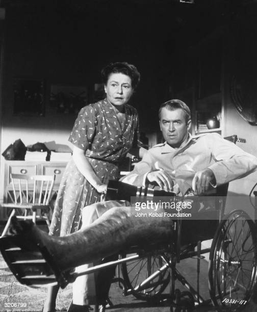 Wheelchair bound James Stewart with his nurse Thelma Ritter in a scene from Alfred Hitchcock's 'Rear Window'