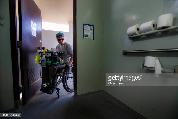 Wheelchair bound Rand Abbott of Joshua Tree prepares to clean a bathroom stall by himself in Joshua Tree National Park on January 8 2019 in Joshua...