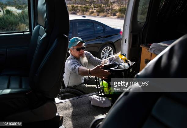 Wheelchair bound Rand Abbott of Joshua Tree puts cleaning supplies back in his van after cleaning a bathroom stall by himself in Joshua Tree National...
