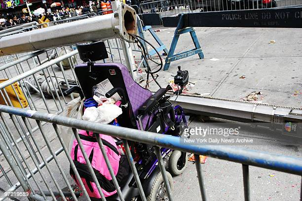 A wheelchair has been left in Times Square after a woman sitting in it was injured when the cables controlling the MM balloon in the 79th annual...