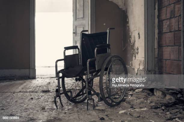 wheelchair in a decadent and scary environment - goose bumps stock pictures, royalty-free photos & images