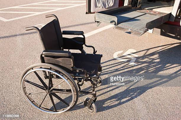 wheelchair in front of a wheelchair accessible vehicle - disabled sign stock photos and pictures
