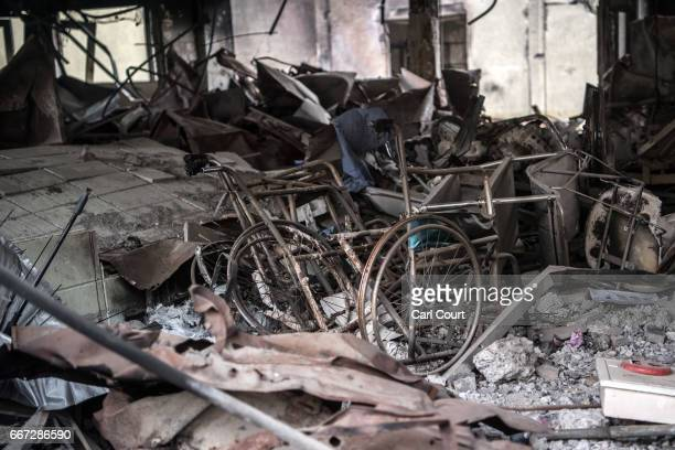A wheelchair is left in the ruins of AlSalam Hospital after the building was destroyed during fighting between Iraqi forces and Islamic State on...