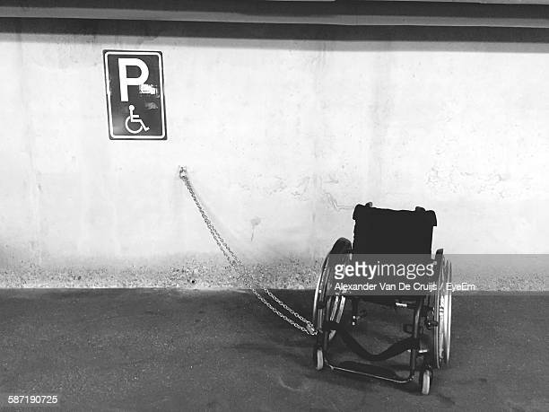 Wheelchair Parked Against Wall