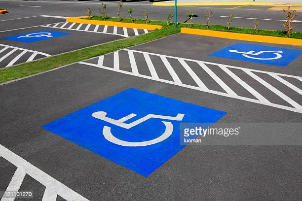 wheelchair parking space - parking sign stock photos and pictures