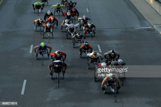 Wheelchair racers make their way down Columbus Drive during the Bank of America Chicago Marathon on October 8 2017 in Chicago Illinois