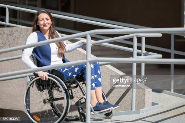 wheelchair ramp help for a young woman - accessibility stock pictures, royalty-free photos & images