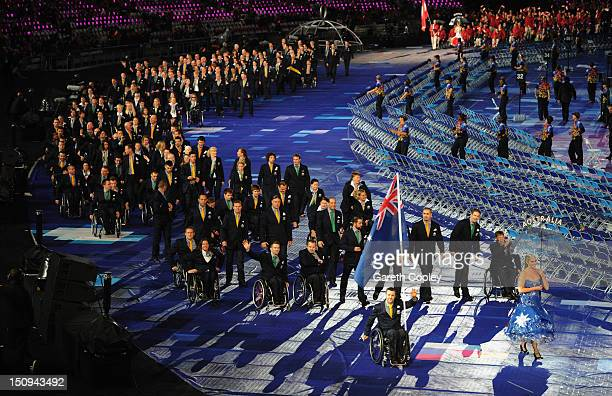 Wheelchair rugby player Greg Smith of Australia carries the flag during the Opening Ceremony of the London 2012 Paralympics at the Olympic Stadium on...