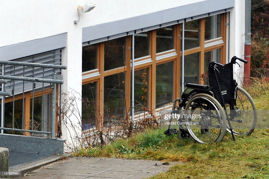 A wheelchair sits at the bottom of stairs at a Caritas employment facility for handicapped where a fire killed 14 people on November 27, 2012 in Titisee-Neustadt, Germany. The fire was reportedly caused by an explosion at the facility, where approximately 120 people with disabilities are employed in light manufacturing.